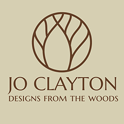Jo Clayton Designs from the woods logo
