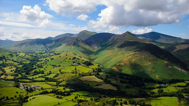 Landscape photograph of the rolling green Lake District mountains in the sunshine